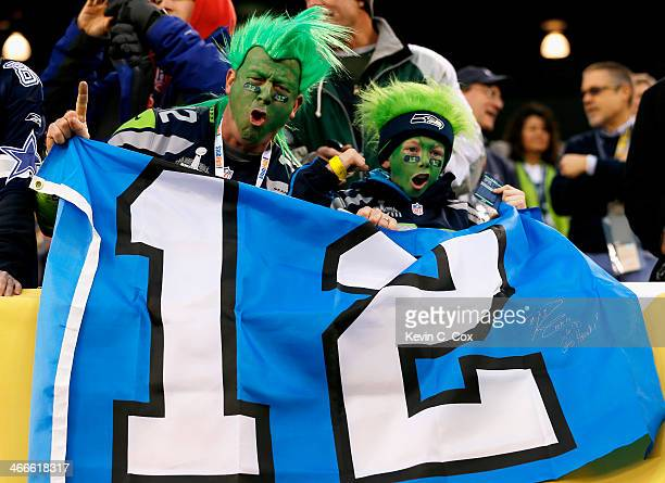 Fans of the Seattle Seahawks hold up a 12th Man Flag before the start of Super Bowl XLVIII between the Seattle Seahawks and Denver Broncos at MetLife...