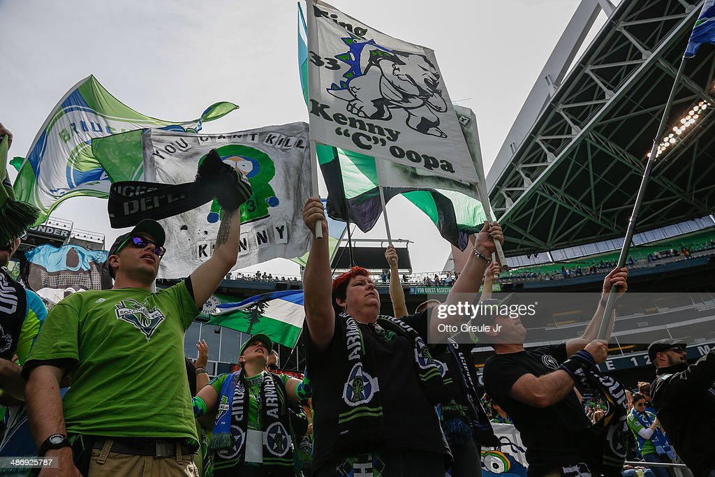 Fans of the Seattle Sounders FC cheer after the match against the Colorado Rapids at CenturyLink Field on April 26, 2014 in Seattle, Washington. The Sounders defeated the Rapids 4-1.