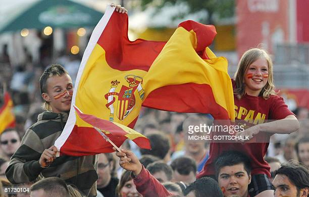 Fans of the Spanish team cheers with their national flags at the 'Fanmeile' in Berlin during the Euro 2008 championships semifinal football match...