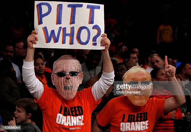 Fans of the Syracuse Orange wear masks with the likeness of Syracuse head coach Jim Boeheim on them against the Pittsburgh Panthers during the...