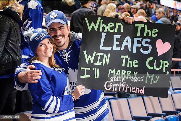 Fans of the Toronto Maple Leafs celebrate the team's victory over the Edmonton Oilers during an NHL game on October 2013 at Rexall Place in Edmonton...