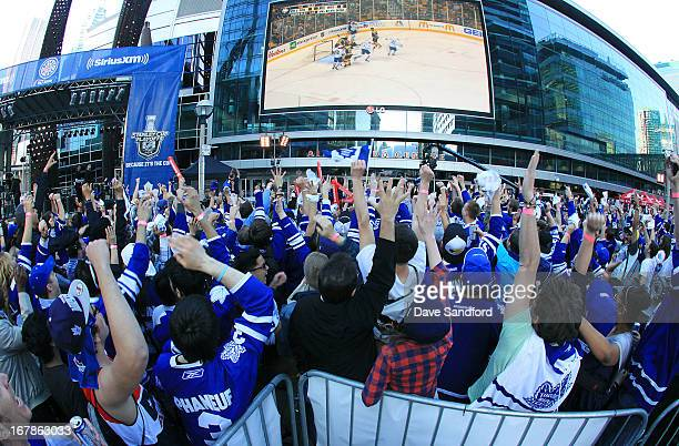 Fans of the Toronto Maple Leafs gather to watch the Boston Bruins v the Toronto Maple Leafs during Opening Night Playoffs Tailgate Party at Maple...