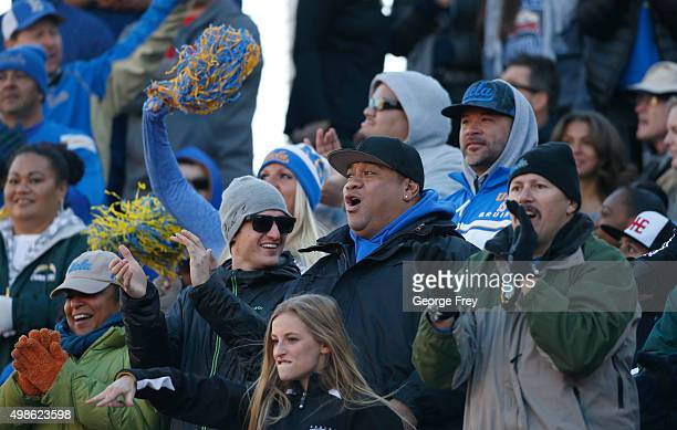 Fans of the UCLA Bruinscheer during a game against the Utah Utes during the first half of a college football game at Rice Eccles Stadium on November...