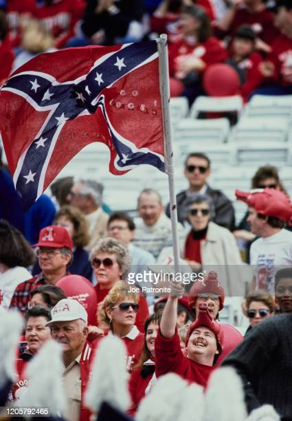 Fans of the University of Arkansas Razorbacks fly the Confederate Stars and Bars flag during the NCAA Southwest Conference college football game on...