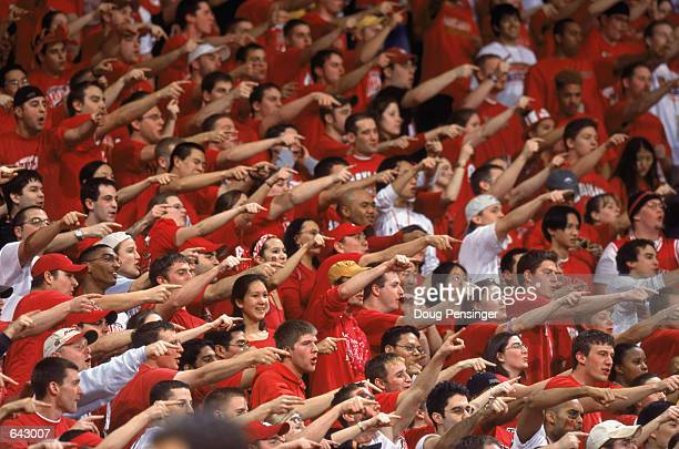 Fans of the University of Maryland Terrapins scream and point at the other team from the student section during the ACC basketball game against the...