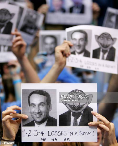 Fans of the University of North Carolina Tar Heels heckle head coach Mike Krzyzewski of the Duke Blue Devils during their game at the Dean E. Smith...