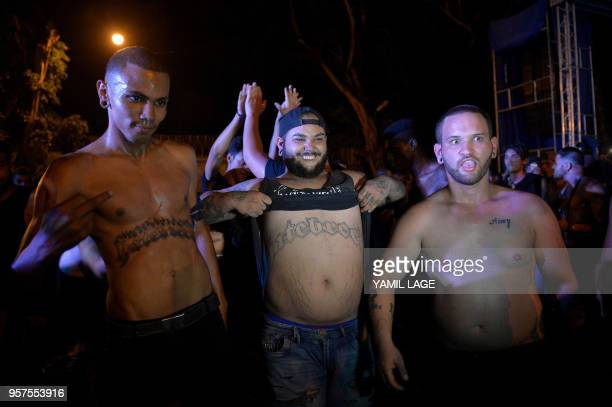 Fans of the US rock group Suicidal Tendencies react during their concert at the Salon Rosado de La Tropical in Havana on May 11 2018