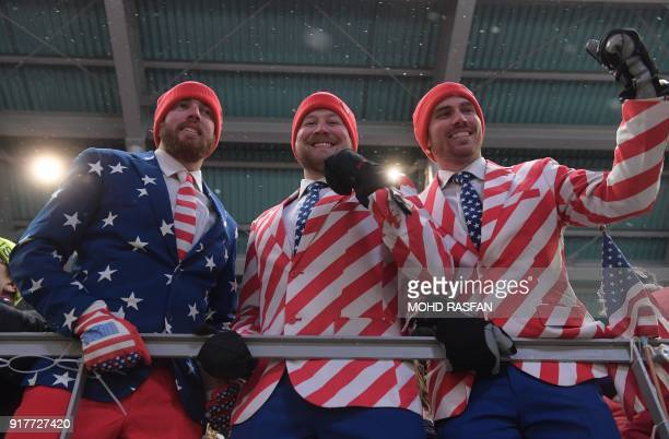 Fans of the US watch the competing in the women's luge singles final run 4 during the Pyeongchang 2018 Winter Olympic Games at the Olympic Sliding...