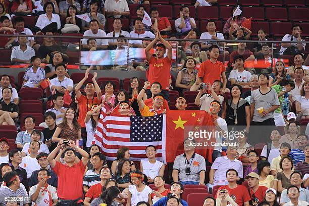 Fans of the U.S. Women's Senior National Team cheer against New Zealand during the women's preliminary round group B basketball match at the 2008...