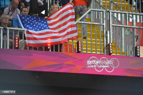 Fans of the USA cheers against China during their Basketball Game on Day 9 of the London 2012 Olympic Games at the Olympic Park Basketball Arena on...