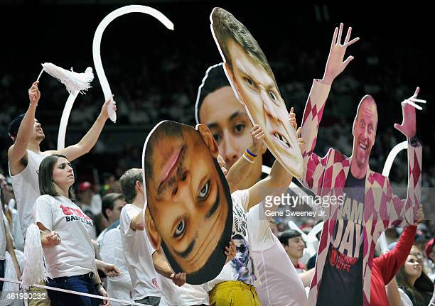 Fans of the Utah Utes cheer using enlarged photos of the team during their game against the Washington State Cougars at the Jon M Huntsman Center on...