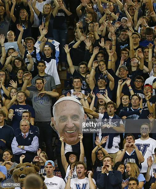 Fans of the Villanova Wildcats hold up a photo of Pope Francis during the second half against the Fairleigh Dickinson Knights in an NCAA college...
