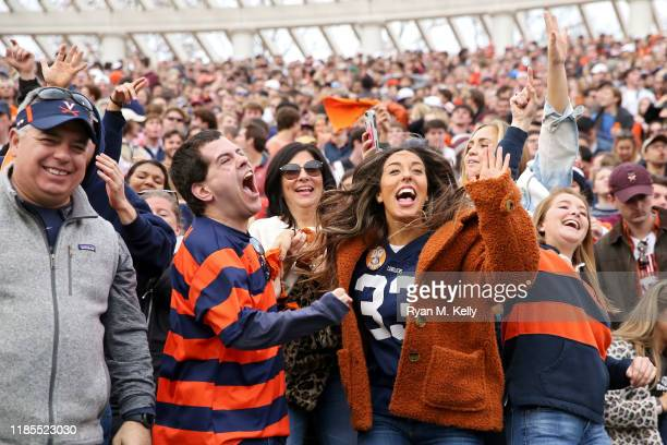 Fans of the Virginia Cavaliers cheers in the second half during a game against the Virginia Tech Hokies at Scott Stadium on November 29, 2019 in...