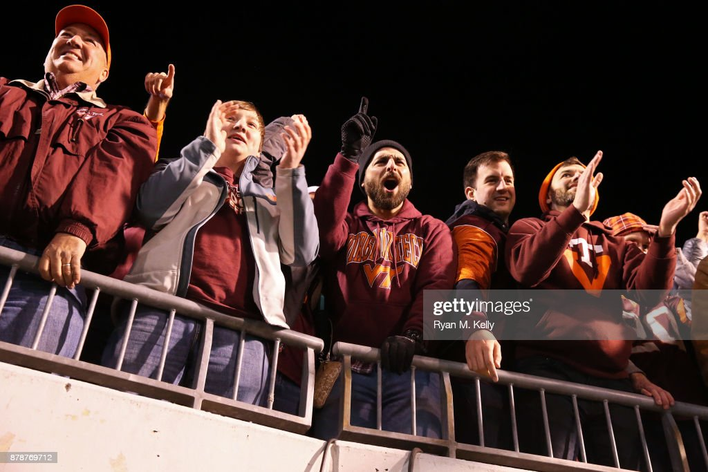 Fans of the Virginia Tech Hokies cheer after a game against the Virginia Cavaliers at Scott Stadium on November 24, 2017 in Charlottesville, Virginia. Virginia Tech defeated Virginia 10-0.