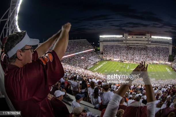 Fans of the Virginia Tech Hokies cheer during a fourth down play against the Duke Blue Devils at Lane Stadium on September 27 2019 in Blacksburg...