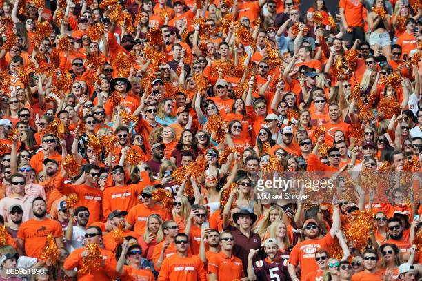 Fans of the Virginia Tech Hokies jump up and down during Enter Sandman prior to the game against the North Carolina Tar Heels at Lane Stadium on...