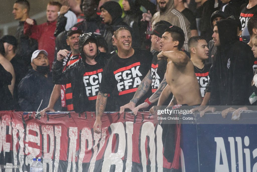 Fans of the Wanderers display a message for there FFA on their t-shirts during the round 21 A-League match between Sydney FC and the Western Sydney Wanderers at Allianz Stadium on February 25, 2018 in Sydney, Australia.