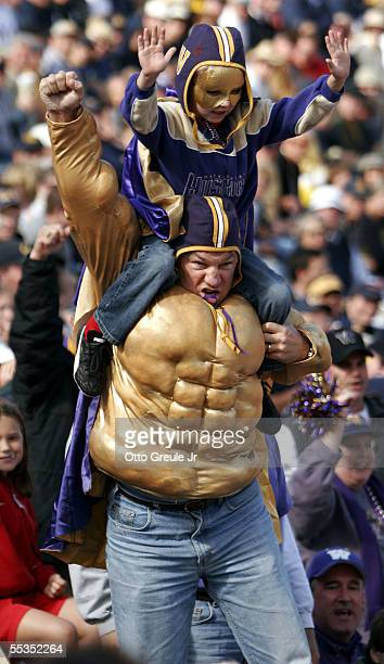 Fans of the Washington Huskies cheer during the game against the California Golden Bears on September 10 2005 at Husky Stadium in Seattle Washington...