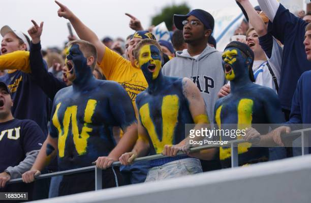 Fans of the West Virginia University Mountaineers cheer on their team during a Big East game against the University of Miami Hurricanes on October 26...