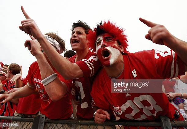 Fans of the Wisconsin Badgers celebrate after defeating the Arkansas Razorbacks in the Capitol One Bowl at Florida Citrus Bowl January 1 2007 in...