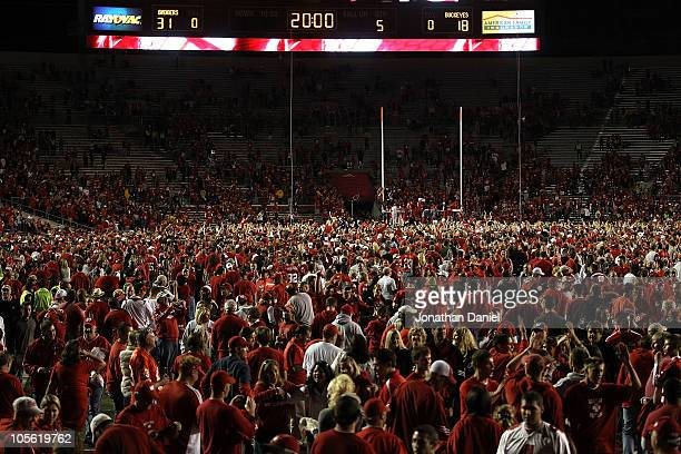 Fans of the Wisconsin Badgers storm the field after a win over the Ohio State Buckeyes at Camp Randall Stadium on October 16 2010 in Madison...