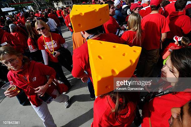 Fans of the Wisconsin Badgers walk outside the Rose Bowl wearing cheese hats prior to playing the TCU Horned Frogs in the 97th Rose Bowl game on...