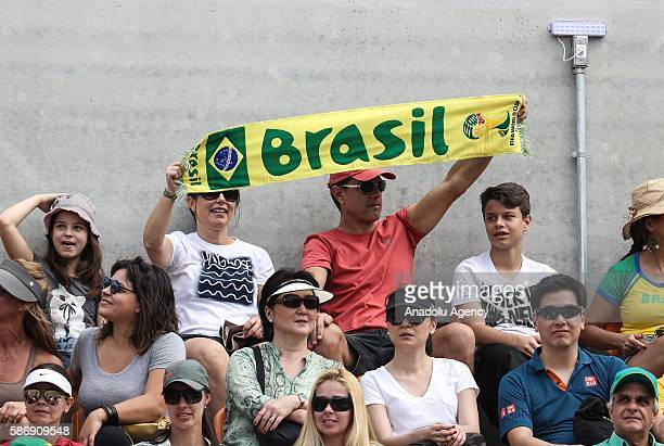 Fans of Thomaz Belluci of Brazil hold Brazil scarf during the tennis match against German tennis player Brown Dustin in Rio de Janeiro Brazil on...
