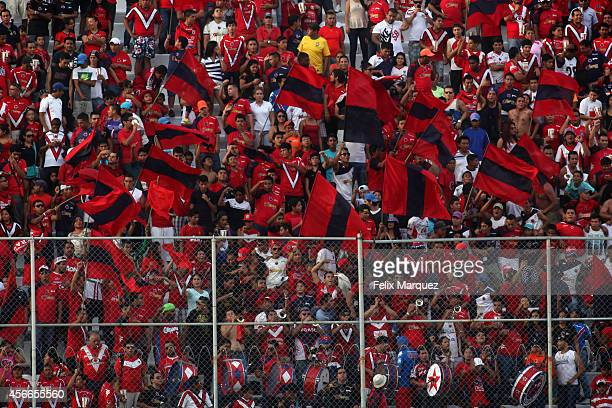 Fans of Tiburones Rojos cheer for their team during a match between Veracruz and Tigres UANL as part of 12th round Apertura 2014 Liga MX at Luis...