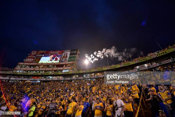 Fans of Tigres cheer the team during the final first leg match between Tigres UANL and Monterrey as part of the CONCACAF Champions League 2019 at...