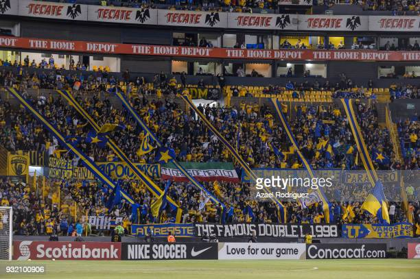 Fans of Tigres cheer the team during the quarterfinals second leg match between Tigres UANL and Toronto FC as part of the CONCACAF Champions League...