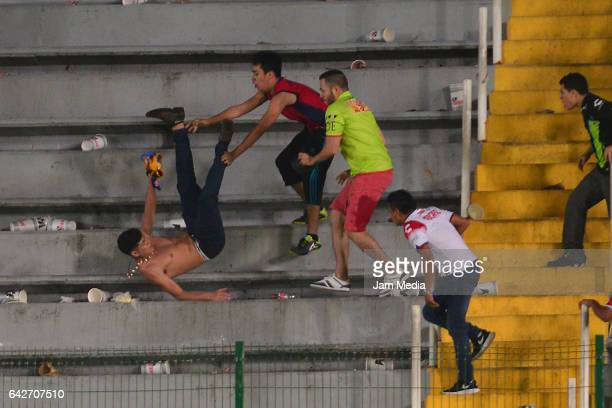 Fans of Tigres UANL and Veracruz clash during the 7th round match between Veracruz and Chiapas as part of the Torneo Clausura 2017 Liga MX at Luis...