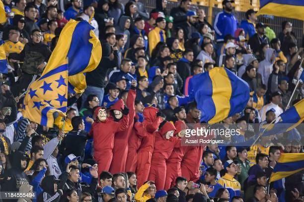 Fans of Tigres wearing halloween costumes cheer the team during the 16th round match between Tigres UANL and Toluca as part of the Torneo Apertura...