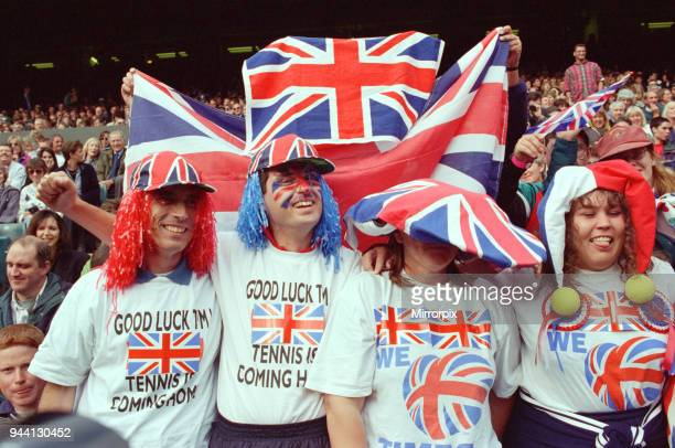 Fans of Tim Henman support the English tennis player during his Fourth Round Match of the Mens Singles with Holland's Richard Krajicek at Wimbledon...