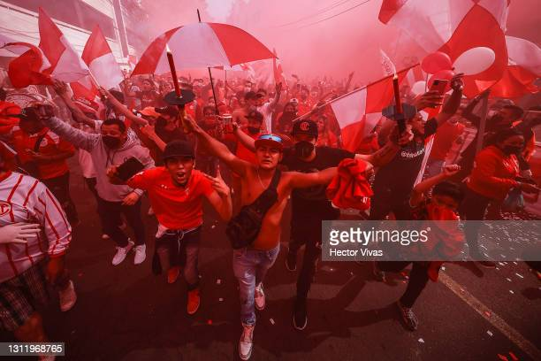 Fans of Toluca cheer during the 14th round match between Toluca and Monterrey as part of the Torneo Guard1anes 2021 Liga MX at Nemesio Diez Stadium...