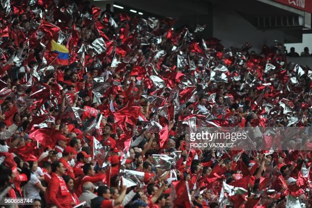 Fans of Toluca cheer their team during the Mexican Clausura 2018 tournament football semi final match against Santos at the Nemesio Diez stadium in...
