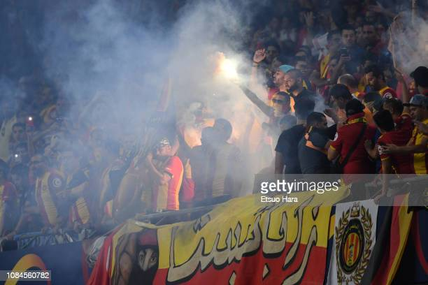 Fans of Tunis cheer during the match between ES Tunis and CD Guadalajara on December 18 2018 in Al Ain United Arab Emirates