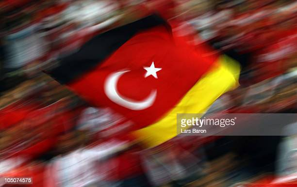 Fans of Turkey wave a flag during the EURO 2012 Group A qualifier match between Germany and Turkey at Olympic Stadium on October 8 2010 in Berlin...