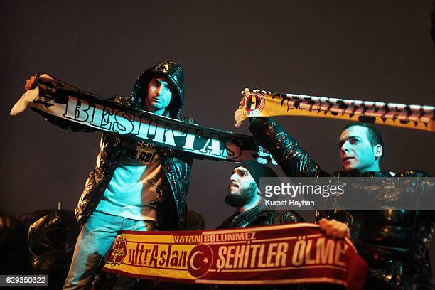 Fans of Turkish soccer teams shout slogans as they protest against the 10 December's terror attack in Istanbul December 12 2016 in Istanbul Turkey At...