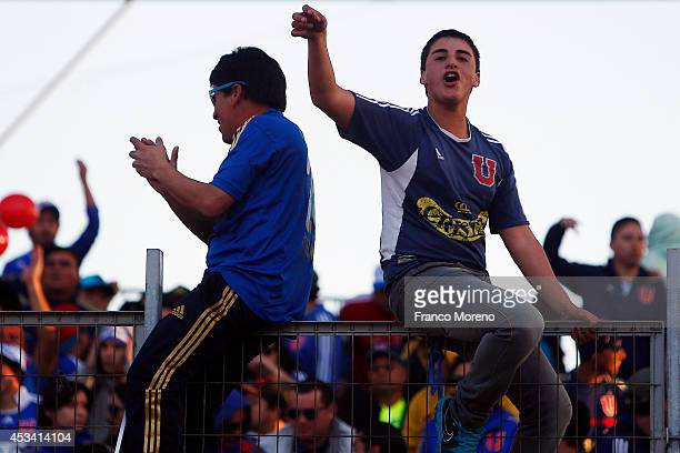 Fans of U de Chile cheer for their team during a match between Antofagasta and U de Chile as part of fourth round of Torneo Apertura 2014 at Regional...