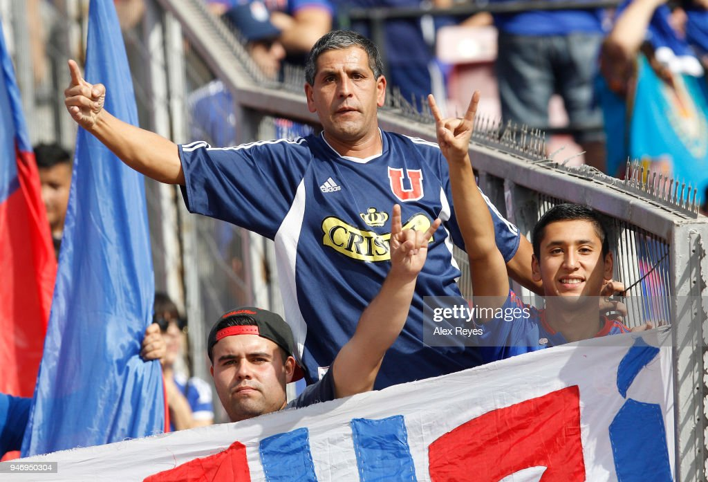 Fans of U de Chile cheer for their team during a match between U de Chile and Colo Colo as part of Torneo Scotiabank 2018 at Nacional Stadium of Chile on April 15, 2018 in Santiago, Chile.