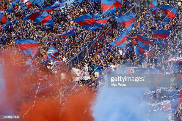 Fans of U de Chile cheer for their team during a match between U de Chile and Colo Colo as part of Torneo Scotiabank 2018 at Nacional Stadium of...