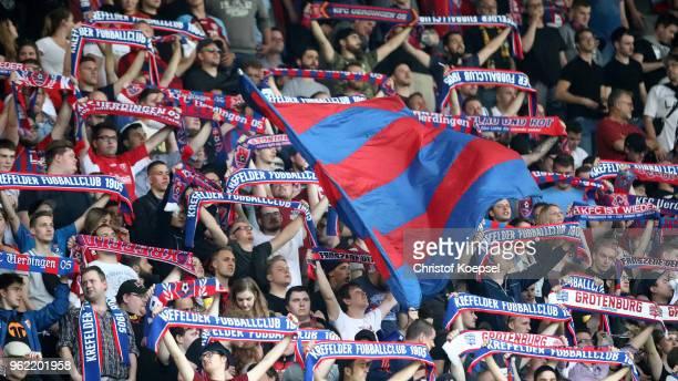 Fans of Uerdingen aves flags during the Third League Playoff first leg match between KFC Uerdingen and Waldhof Mannheim at SchauinslandReisenArena on...