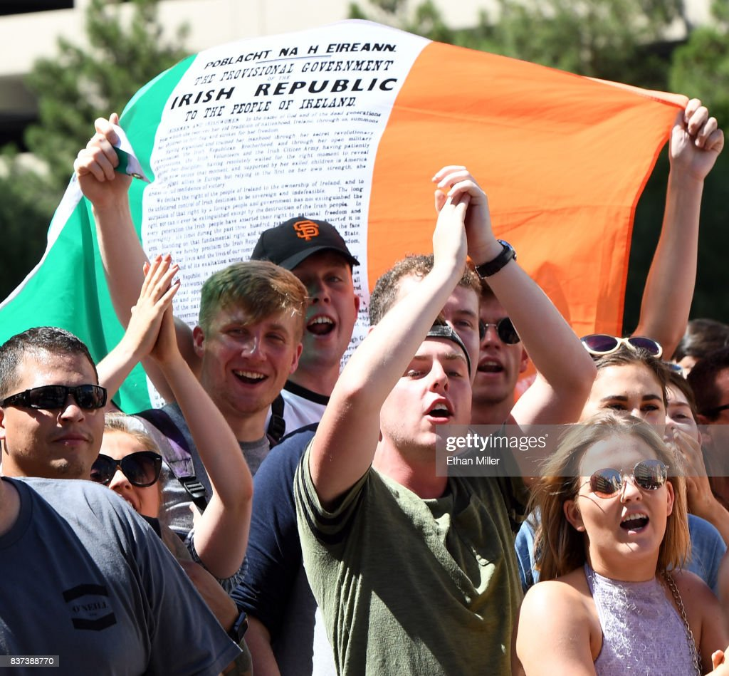 Fans of UFC lightweight champion Conor McGregor cheer as he arrives at Toshiba Plaza on August 22, 2017 in Las Vegas, Nevada. McGregor will fight Floyd Mayweather Jr. in a super welterweight boxing match at T-Mobile Arena on August 26 in Las Vegas.