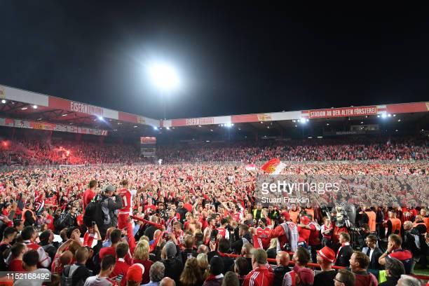 Fans of Union Berlin celebrate after the Bundesliga playoff second leg match between 1 FC Union Berlin and VfB Stuttgart at Stadion an der alten...