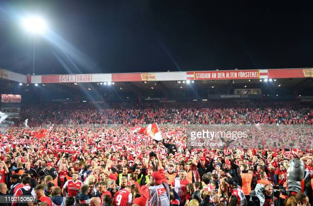 Fans of Union Berlin celebrate after their team is promoted to the first Bundesliga for the first time in the club's history after the Bundesliga...