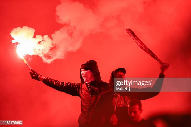 Fans of Union burn fire during the Bundesliga match between 1. FC Union Berlin and Hertha BSC at Stadion An der Alten Foersterei on November 02, 2019...