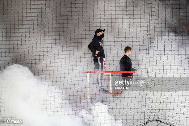 Fans of Union burn fire prior to the Bundesliga match between 1. FC Union Berlin and Hertha BSC at Stadion An der Alten Foersterei on November 02,...