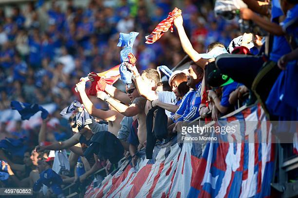 Fans of Universidad de Chile cheer for their team during a match between Nublense and Universidad de Chile as part of round 16 of Torneo Apertura...