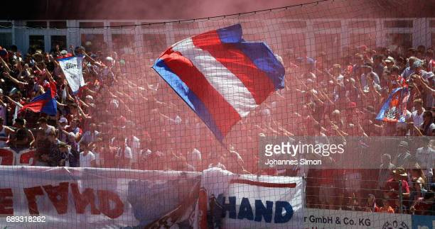 Fans of Unterhaching celebrate prior the third league playoff leg one match at Alpenbauer Sportpark on May 28, 2017 in Unterhaching, Germany.