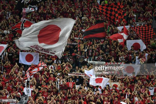 Fans of Urawa Red Diamonds celebrate their 41 win after the AFC Champions League quarter final second leg match between Urawa Red Diamonds and...